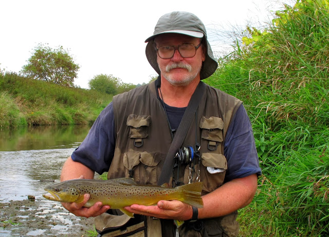 angler with brown trout