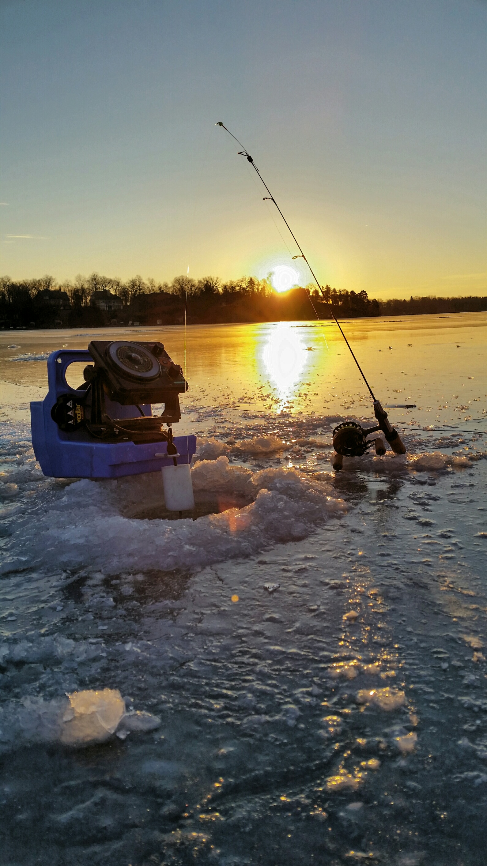5 tips for a successful ice fishing season the fishidy blog for Ice fishing hole