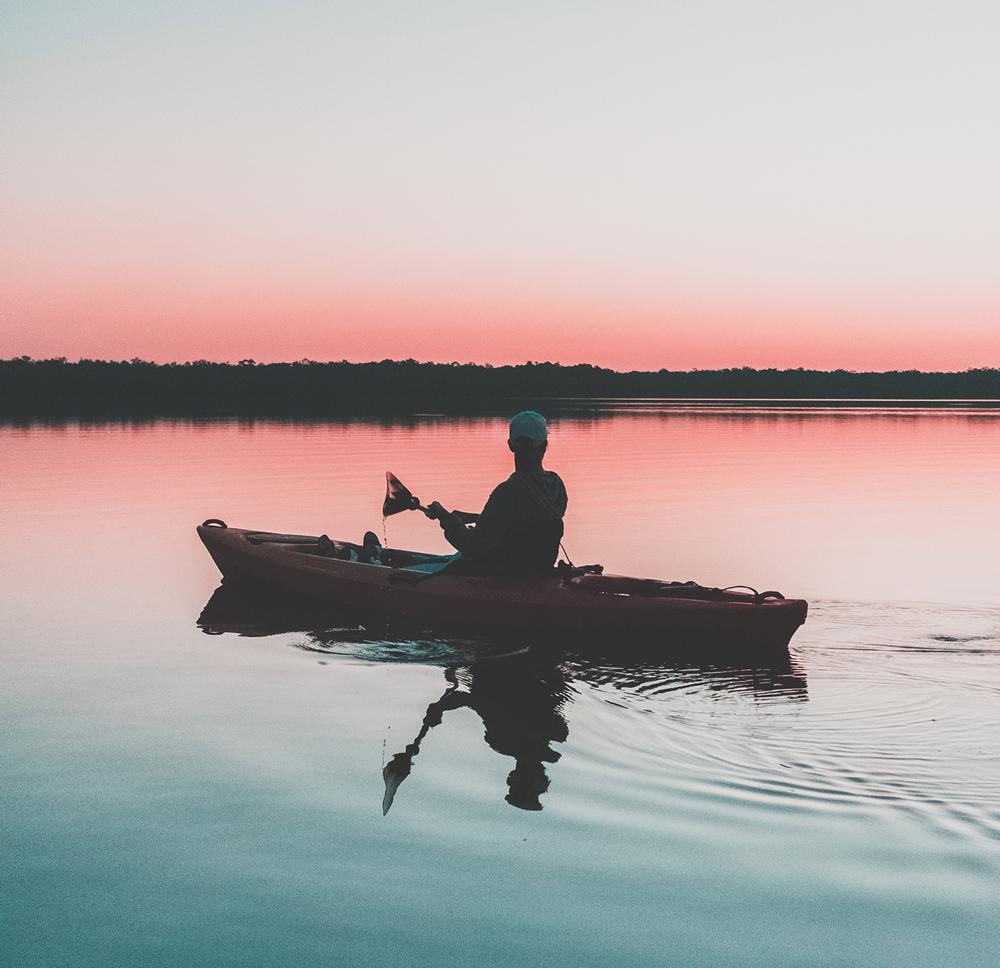 kayak angler paddling